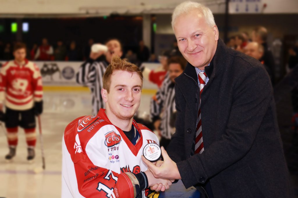 Rich Slater is president with his 200th goal puck by Andy Gordon, Barons co-chair (Steve Crampton)