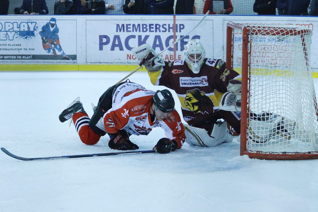 Tom Soar tumbles into the Warriors crease (Steve Crampton)