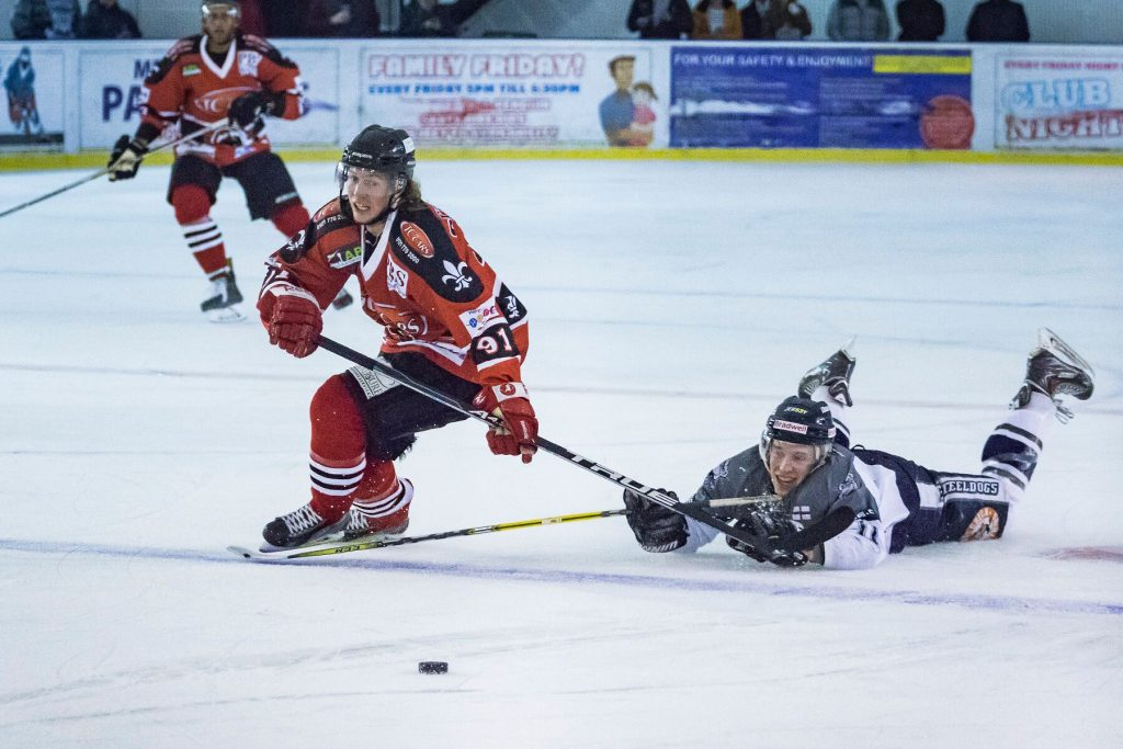 Niklas Ottosson races past a sprawled Thomas Relf (S Crampton)