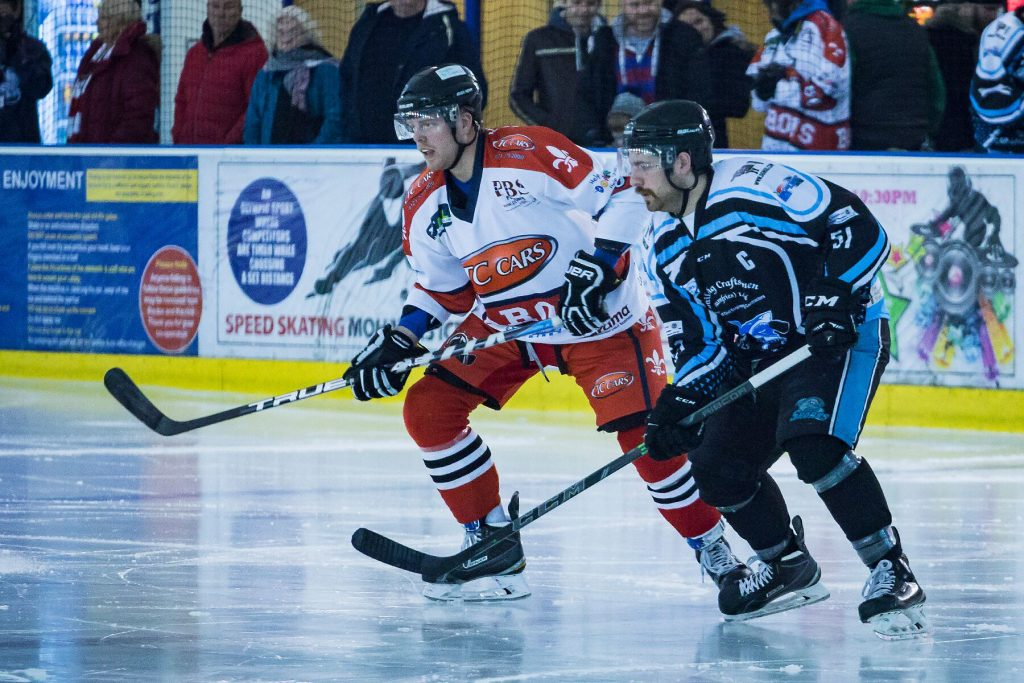 Tom Soar of the Barons and Struan Tonner of the Sharks follow the play (Steve Crampton)